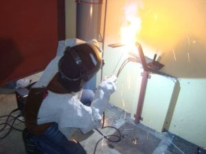 A trainee in 4G Welding Position